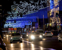 Christmas city lights over street traffic Stock Photography