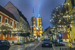 Christmas cityscape - evening view of the Cathedral of St. John the Baptist, located in the Ostrow Tumski old district of the city. Of Wroclaw, in Lower Silesia royalty free stock image