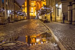 Christmas cityscape - view on reflection in water of the Cathedral of St. John the Baptist, located in the Ostrow Tumski old distr. Ict of the city of Wroclaw royalty free stock photography