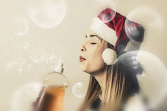 Christmas cleaning housewife. Creative vintage portrait of a beautiful blond housewife blowing away dirt and grime when preparing for the holiday season Stock Image