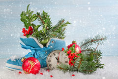 Christmas clock with boots Stock Photos