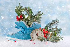 Christmas clock with boots Stock Photography