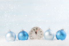 Christmas clock with Christmas balls. Royalty Free Stock Photo