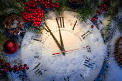 Christmas clock and decoration on snow Stock Photos