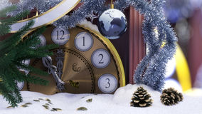 Christmas clock,earth decoration ,key and fir branches covered with snow concept background Royalty Free Stock Photography