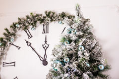 Christmas clock and fir tree Stock Photos