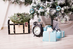 Christmas clock and fir tree Stock Images