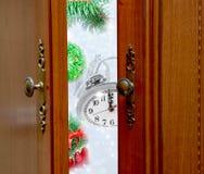 Christmas clock five minutes left door open Royalty Free Stock Photos