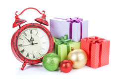 Christmas clock, gift boxes and bauble decor Royalty Free Stock Image