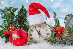 Christmas clock with Holly leaves and berries Stock Photography