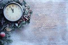 Christmas Clock Over Snow Wooden Background. Stock Photography