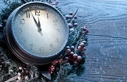 Christmas clock over snow wooden background. Stock Images