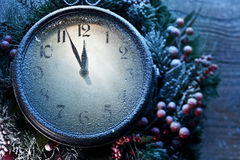 Christmas clock over snow wooden background. Stock Photo