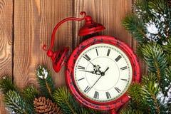 Christmas clock and snow fir tree Stock Image