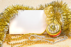 Christmas clock with tinsel and postcard Stock Photos