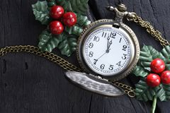 Christmas clock with winter decoration. Happy new year concept royalty free stock photo