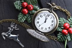 Christmas clock with winter decoration. Happy new year concept royalty free stock images