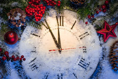 Christmas clock with winter decoration Royalty Free Stock Image