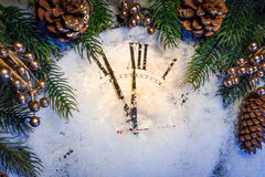 Christmas clock with winter decoration Royalty Free Stock Photo