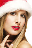 Christmas closeup of a glamorous woman wearing san Royalty Free Stock Photos