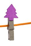 Christmas clothespin on line. Wooden clothespin clipped to clothes line Stock Images