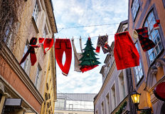 Christmas clothing decoration hanging over street Stock Photography