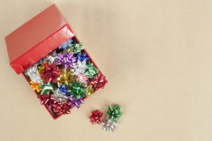 Christmas Cockade in a Boxc. Christmas Color Cockade in a Box in a paper background Stock Photo