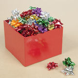 Christmas Cockades in a Box. Christmas Color Cockade in a Box in a paper background Royalty Free Stock Photo