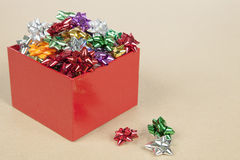 Christmas Cockades in a Box. Christmas Color Cockade in a Box in a paper background Royalty Free Stock Photography