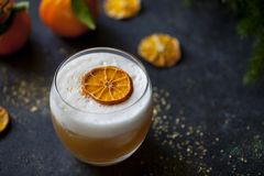 Christmas cocktail of amaretto sour stock photography