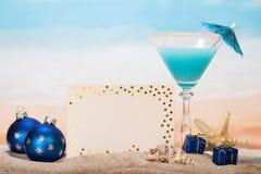 Christmas cocktail with umbrella and starfish Stock Photos