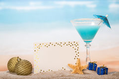 Christmas cocktail with umbrella and starfish Stock Photo