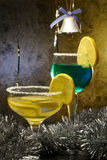 Christmas Cocktails with lemons. Two Cocktails with lemons and Christmas decorations Stock Images