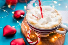 CHRISTMAS COCOA in a red striped cup Christmas mood, new year, holidays, christmas,. CHRISTMAS COCOA in a red striped cup Christmas mood stock photos