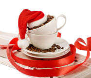 Christmas coffee. Cups with santa hat Stock Images