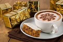 Christmas Coffee Break. With a cappuccino and slice of cake Royalty Free Stock Image