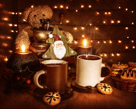 Christmas coffee with cookies. Christmas still life, tasty traditional dessert, two cups of coffee with tasty cookie, teddy bear and little decorative Xmas tree Royalty Free Stock Images