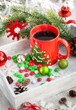 Christmas coffee cup and candies Stock Photos