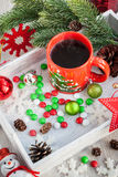 Christmas coffee cup and candies Royalty Free Stock Image