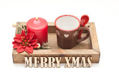 Christmas. Coffee cup and candle Royalty Free Stock Photos
