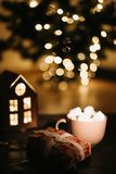 Christmas coffee cup with marshmallows. Still life on dark background. New Year`s lights and decorations stock photos