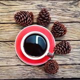 Christmas coffee cup. Coffee cup with reindeer headband on wooden board background royalty free stock photo