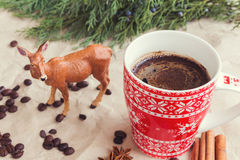Christmas coffee and deer. Christmas coffee in red cup and deer Royalty Free Stock Image