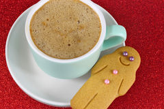 Christmas Coffee and gingerbread man on red glitter background Royalty Free Stock Photo