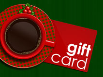 Christmas coffee with holy and gift card lying on tablecloth Stock Image