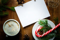 Christmas coffee latte or cappuccino with a notebook. For list of gifts or a wishlist, Christmas tree branch, pine cones and Christmas balls, vertical, copy Royalty Free Stock Images