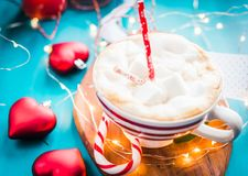 Christmas coffee with marshmallow in a red striped cup Christmas mood, new year, holidays, christmas,. Christmas coffee with in a red striped cup Christmas mood Stock Photography