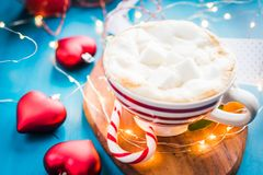 Christmas coffee with marshmallow in a red striped cup Christmas mood, new year, holidays, christmas,. Christmas coffee with in a red striped cup Christmas mood Stock Images