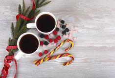 Christmas coffee. Sugar cane, spruce twig on a gray background Royalty Free Stock Photography