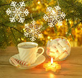 Christmas coffee with sweets and candles Stock Photography